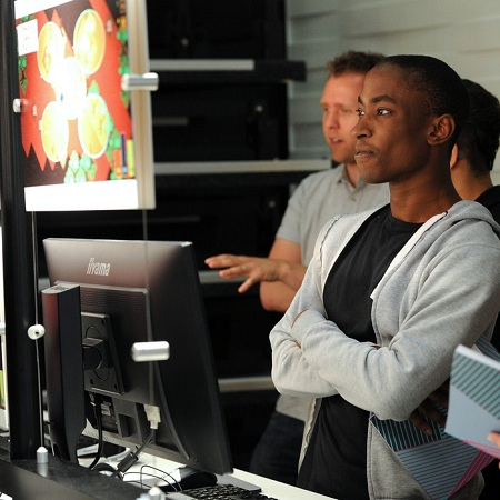 students-at-Digital-Design-Show-2017-looking-at-double-height-computer-screens